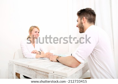 A happy young couple organizing their financial situation at home.