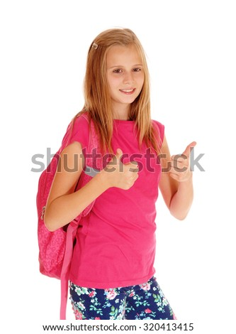 A happy young girl in a pink sweater and backpack holding both thump's