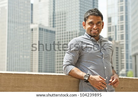 A happy young indian man from Malaysia. - stock photo