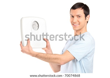A happy young man holding a weight scale isolated on white background