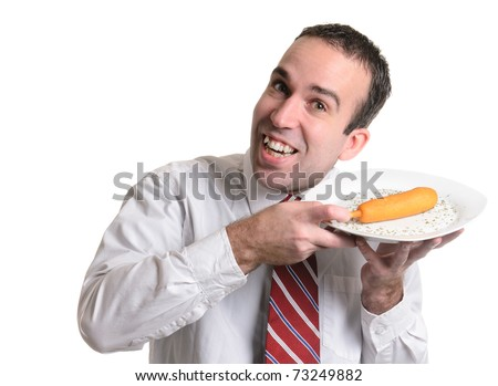 A happy young man is displaying his corn dog isolated against a white background. - stock photo
