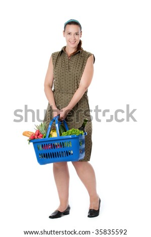 A happy young shopper in a supermarket scenario with a full shopping basket.
