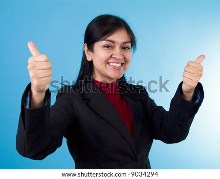 A happy young woman displaying extreme approval with a thumbs up gesture. - stock photo