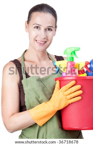 A happy young woman with cleaning equipment ready to clean - on white. - stock photo