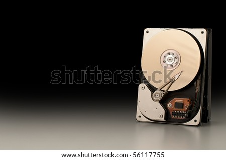 A hard disk isolated on black background - stock photo