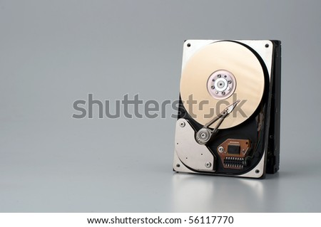 A hard disk isolated on grey background - stock photo