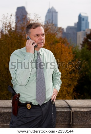 A hard nose detective on his cell phone