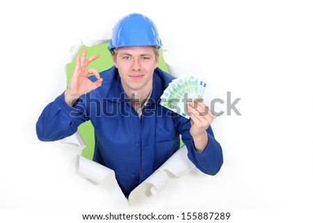 A hard-working tradesman earning an honest living - stock photo