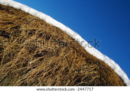 a hay is snow and sky - stock photo