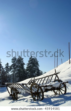 A hay wagon in the snow Brasov Transylvania Romania. - stock photo