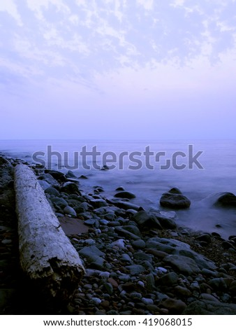 A Hazy but Colorful Lake Superior Evening - stock photo