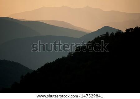 A hazy shot across the Montenegro mountains. - stock photo