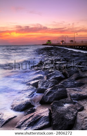 A HDR image of St. Kilda Beach (Australia) and Pier at twilight - stock photo