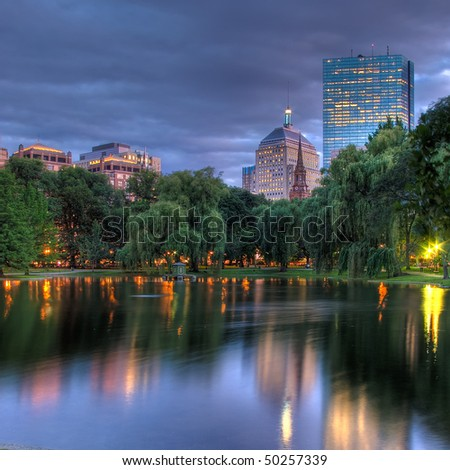 A HDR view of the Hancock towers in Boston viewed across the pond at the Public Gardens - stock photo