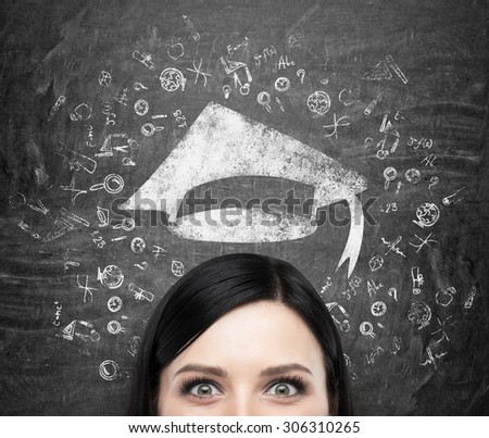 A head of young brunette lady who is thinking about university education. Drawn educational icons and a graduation hat on the black chalkboard background . - stock photo