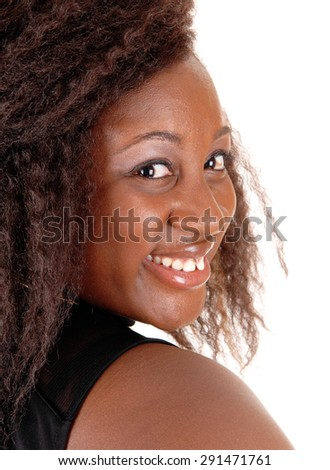 A head shoot of a young African American woman in a black dress, 