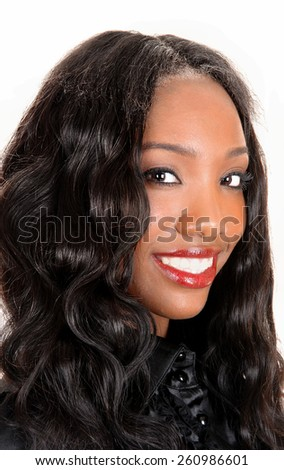 A head shot of a beautiful African American woman with long black