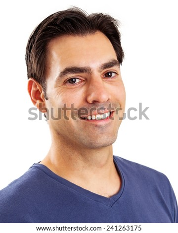 A head shot of a handsome man in his early thirties with dark hair and eyes wearing a blue t-shirt with a friendly smile