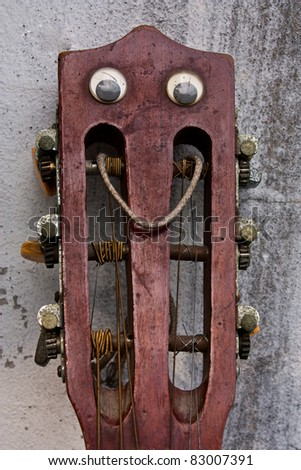A header image of guitar. Placed upon the old walls. - stock photo