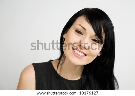 A headshot of a beautiful smiling businesswoman - stock photo