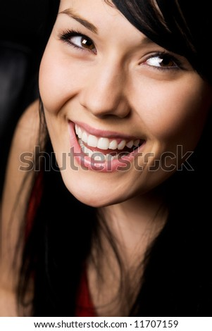 A headshot of a beautiful smiling woman - stock photo