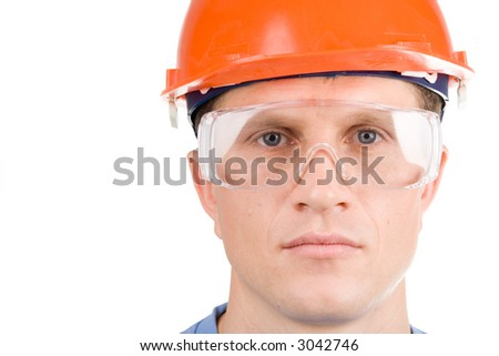 A headshot of a builder in hardhat - stock photo