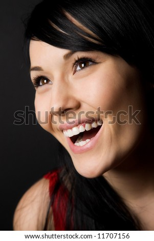 A headshot of a happy beautiful woman