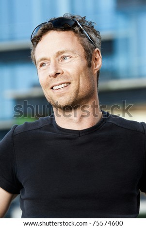 A headshot of a middle aged man in a casual setting - stock photo