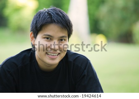 A headshot of an asian college student - stock photo