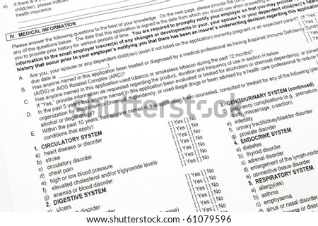 A health insurance application medical information section ready to be filled out. - stock photo