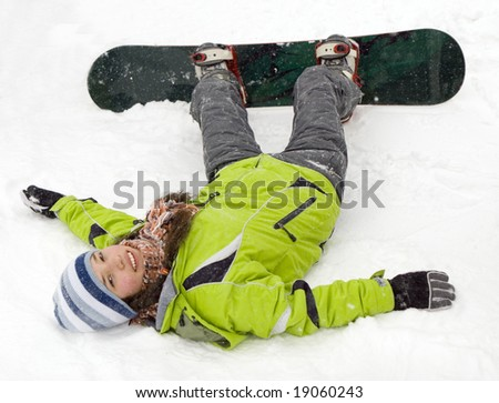 A health lifestyle image of young adult (age 18-20) snowboarder girl after incidence - stock photo