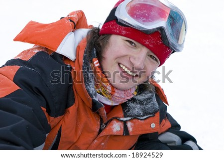 A health lifestyle image of young adult  snowboarder - stock photo
