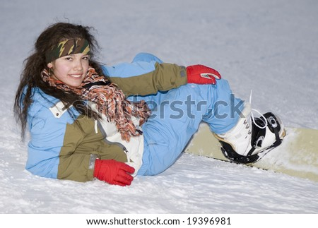 A health lifestyle image of young adult snowboarder girl after incidence  in the evening mountains - stock photo