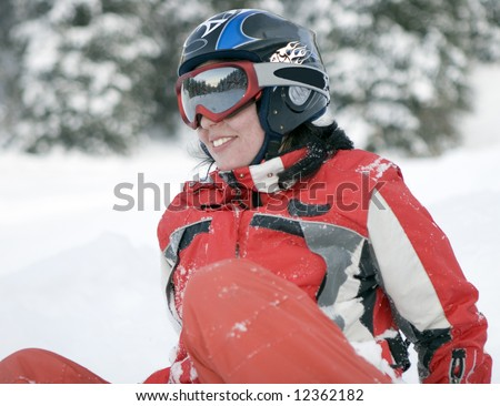 A health lifestyle image of young adult  snowboarder girl after incidence (series sport, mountains, extreme, horses, teenagers) - stock photo