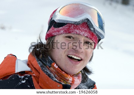 A health lifestyle image of young adult snowboarder with wet face after incidence - stock photo