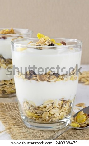 A healthy breakfast muesli and yoghurt mix layered in a glass - stock photo