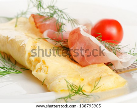 A healthy breakfast.Omelet with bacon. Selective focus