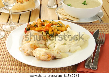 A healthy chicken dinner with celery soup - stock photo