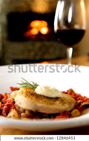 A healthy gourmet sworfish dinner complete with wine and fireplace - stock photo