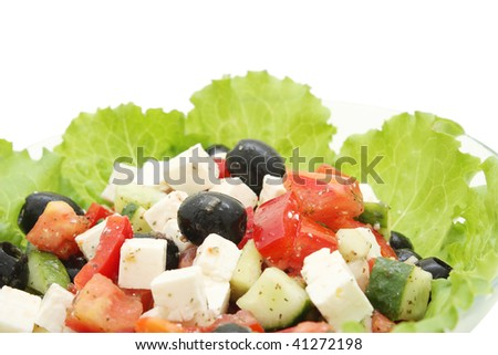A healthy greek salad close up is isolated a white background - stock photo
