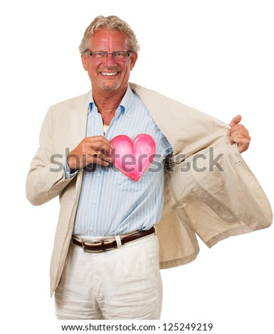 A healthy happy man holding up a love heart in front of his heart. Symbolizing love and health. Isolated on white. - stock photo