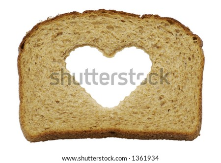 A healthy heart themed slice of whole wheat bread isolated on a white background. - stock photo
