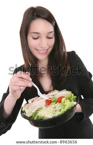 A healthy pretty woman eating a salad - stock photo