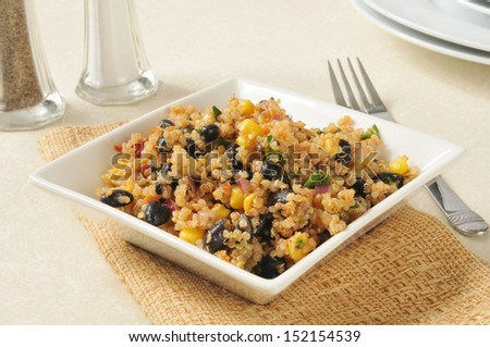 A healthy salad with black beans and qunioa - stock photo