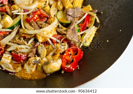 A healthy stir fry wok beef with vegetables. - stock photo