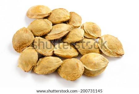 A heap of apricot kernel isolated on white background. - stock photo