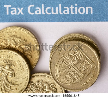 A heap of British pound coins, showing the Welsh leek and the coat of arms of the UK, on a British tax office form. - stock photo
