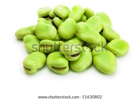 A heap of broad beans isolated on white - stock photo
