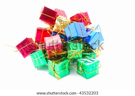 A heap of colorful Christmas gifts wrapped in glossy paper. Image isolated on white studio background.