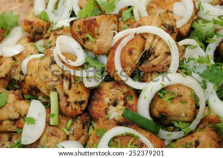 A heap of fried chicken breast with garnish on the Armenian lavash (flatbread) - stock photo